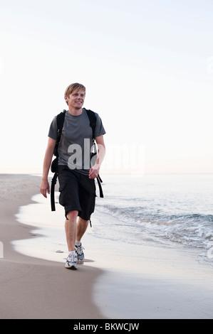 Uomo sulla spiaggia Foto Stock