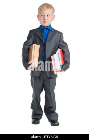 Giovane ragazzo serio , in veste di professore, tenendo i libri sotto le braccia Foto Stock