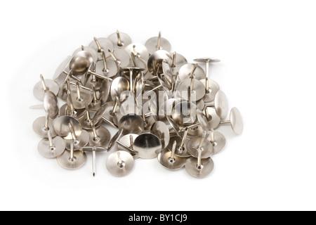 Pila di argento puntine da disegno Foto Stock