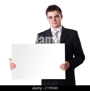 Imprenditore tenendo premuto segno di vuoto Foto Stock