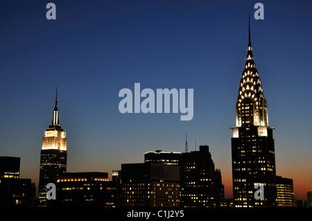 Chrysler Building e Empire State Building insieme a notte Foto Stock