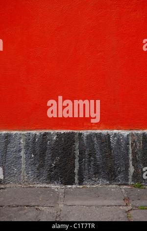 Rosso parete in stucco, close-up Foto Stock
