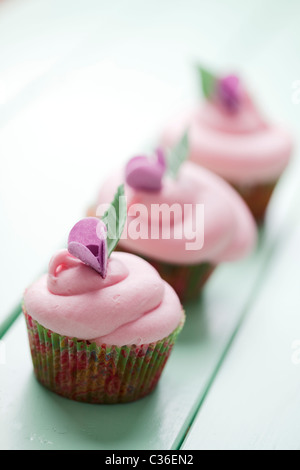 pastello cupcakes Foto Stock