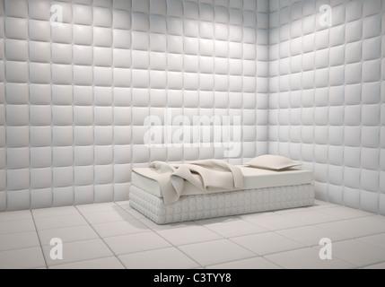Bianco ospedale mentale imbottito angolo della camera con un letto Foto Stock
