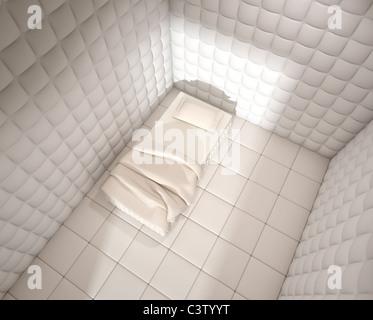 Ospedale psichiatrico camera imbottita visto da sopra con un letto singolo Foto Stock