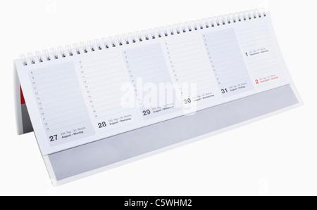 Piccola scrivania calendario contro uno sfondo bianco, close up Foto Stock