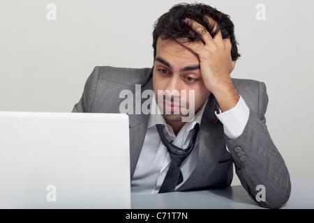 Imprenditore ha sottolineato durante il lavoro Foto Stock