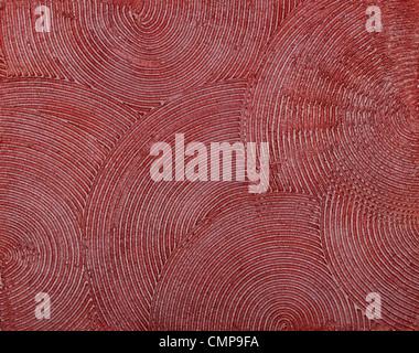 Parete texture con una profonda dabs circolare di putty, coperto con vernice rossa. Foto Stock