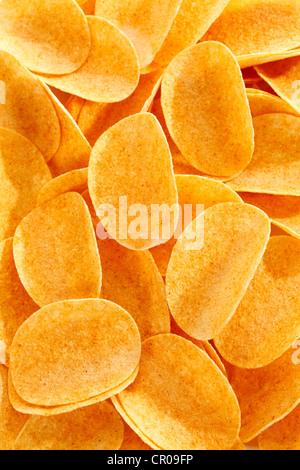 La paprica ovale potato chips, scaglie di impilamento, full-frame Foto Stock