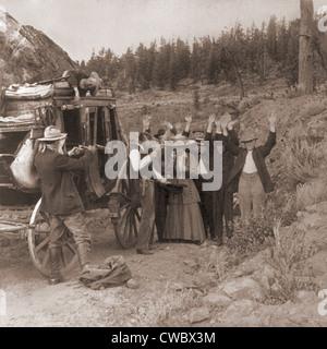 Rievocazione storica di un diligenze rapina da due uomini, chi ha ucciso un uomo che si trova sulla parte superiore Foto Stock