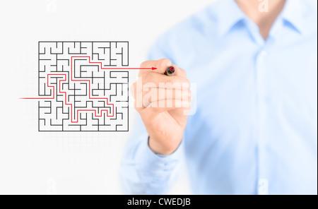 Giovane imprenditore di successo di disegno modo per trovare il concetto di soluzione. Isolato su bianco. Foto Stock