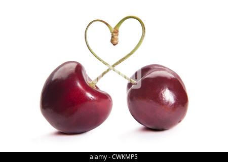 Due le ciliegie wit a forma di cuore Foto Stock