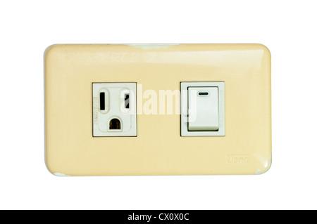 Vecchio multi power combinazione interruttore della luce e presa di corrente isolati su bianco Foto Stock