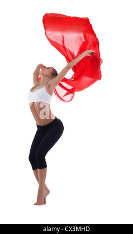 Giovane donna bionda danza con red battenti tessuto isolato Foto Stock