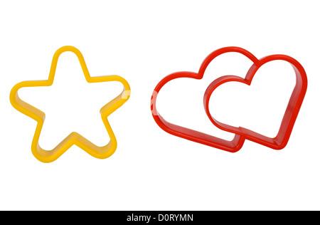Close-up di una stella e una a forma di cuore ad cookie cutters Foto Stock