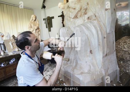 Scultore del cesello figura da legno