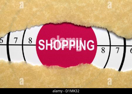 Testo di Shopping sul foro della carta Foto Stock