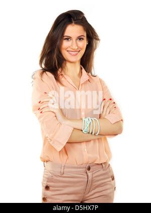 Donna aziendale con i bracci ripiegati contro uno sfondo bianco Foto Stock