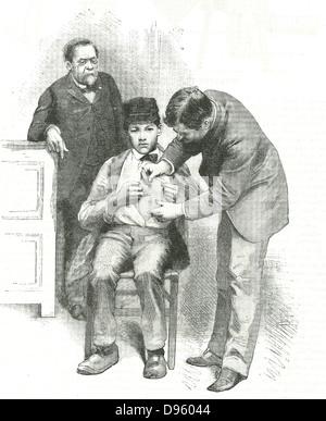 Louis Pasteur (1822-1895) chimico francese, cerca su come il suo assistente inocula Joseph Meister, un pastorello Foto Stock