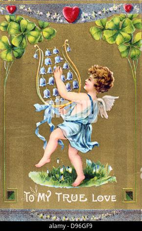 Per il mio amore vero, c1910. American Valentine card. Cupido danze sull erba con bucaneve naturalizzate e è la Foto Stock