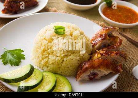 Hainan riso al pollo , singapore cibo con materiali come sfondo Foto Stock