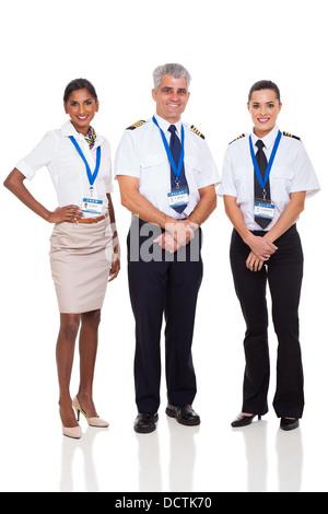 Ritratto del capitano senior con la compagnia aerea equipaggio su sfondo bianco Foto Stock