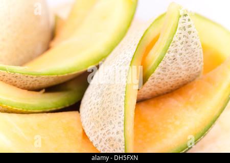 Foto macro di melone pezzi di pelle giacente insieme Foto Stock