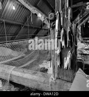 Rendendo netto e net rigging loft al cantiere Sladers,West Bay,Bridport,Dorset circa 1983 Foto Stock