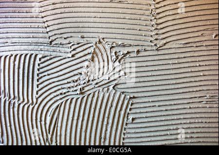 Piastrelle di colla per il fissaggio della parete di piastrelle