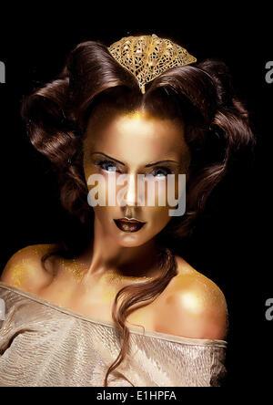 Stile drammatico. Donna Oro dorato faccia - Teatro del lusso compongono Foto Stock