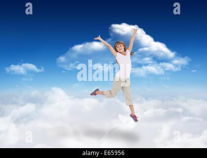 Immagine composita di felice ragazza jumping Foto Stock