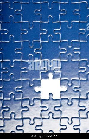 Blue jigsaw puzzle, un pezzo mancante Foto Stock