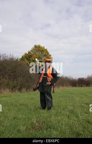 Corno da caccia chiamata ventilatore spento la battue, Germania Foto Stock
