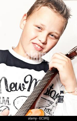 Giovani guitar player Foto Stock