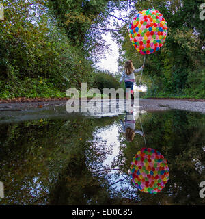 Ragazza con palloncini Foto Stock