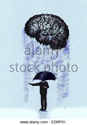 Imprenditore con ombrello controllo pioggia dal cervello Foto Stock
