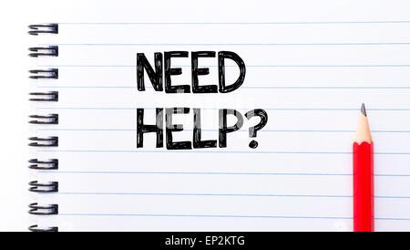 Hai bisogno di aiuto per scrivere del testo sulla pagina del notebook, matita rossa sulla destra. Motivazionali Foto Stock