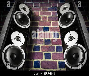 Nero ad alta brillantezza diffusori di musica su un muro di mattoni