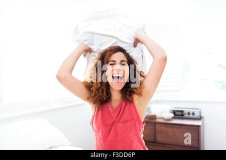 Donna cuscino di contenimento Foto Stock