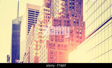 Vintage tonica alta immagine chiave di grattacieli contro il sole, New York, Stati Uniti d'America. Foto Stock