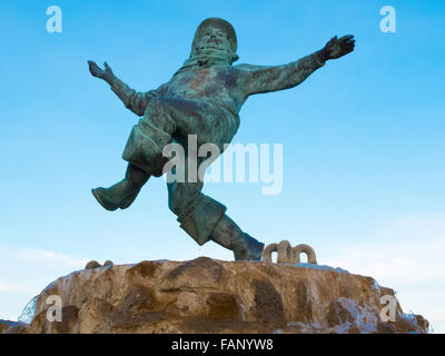 Il Jolly Fisherman statua in Compass Gardens,Tower Gardens vicino al fronte mare a Skegness. Foto Stock