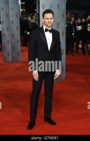 Tom Hiddleston arriva all'EE British Academy Film Awards 2015, presso la Royal Opera House, Bow Street, Londra.