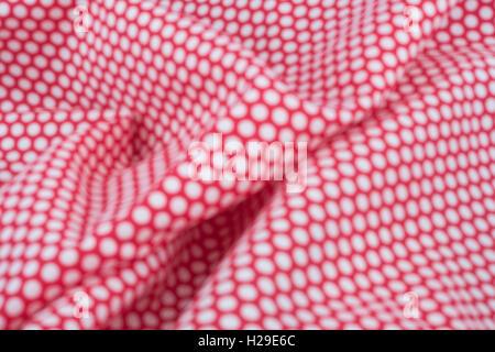 Abstract fuori fuoco rosso-bianco polka dot materiale. Concetto di 'International Dot giorno' e forse una personalità dotty dotty, persona. Foto Stock