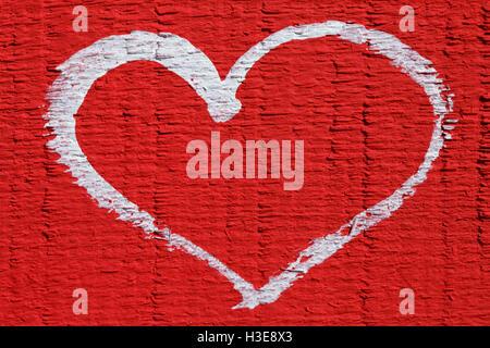 Un cuore bianco su sfondo rosso, bellissimo sfondo astratto amore
