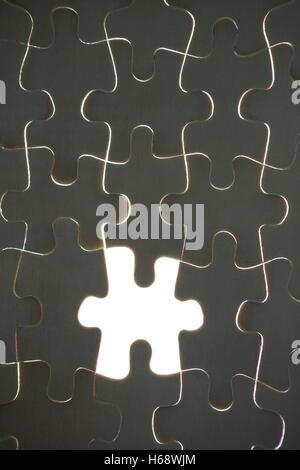 Un pezzo del puzzle mancanti da jigsaw Foto Stock