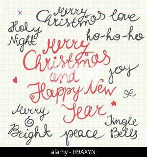 Scritte a mano per Natale e Anno nuovo lettering isolato su un foglio di carta millimetrata sfondo. Foto Stock