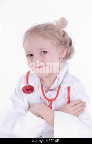 Sette-anno-vecchia ragazza vestito come un medico Foto Stock