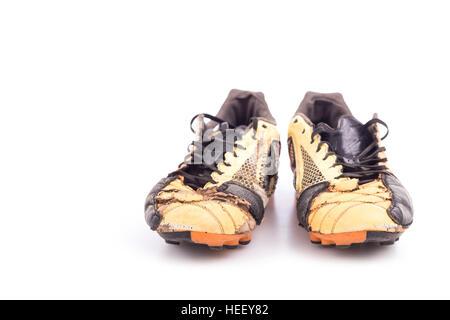 Vecchie scarpe da calcio isolati su sfondo bianco Foto
