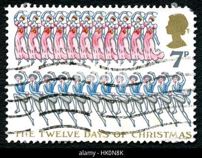 Gran Bretagna - circa 1977: un usato francobollo dal Regno Unito che commemora i Dodici giorni di Natale, circa Foto Stock
