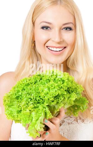 Donna che mantiene la lattuga fresca Foto Stock